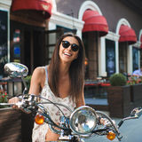 Young attractive girl and vintage old scooter Royalty Free Stock Photo