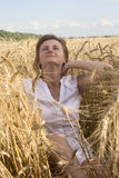 Young attractive girl in a wheat field. Royalty Free Stock Images