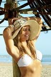 Young attractive girl in white bikini tanning at the beach Royalty Free Stock Photo