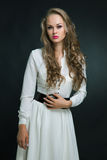 Young attractive girl in white dress Stock Photography