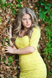 Young attractive girl with yellow dress outdoor Royalty Free Stock Photo