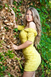 Young attractive girl with yellow dress outdoor Stock Photo