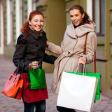Young attractive girlfriends go shopping Royalty Free Stock Photos