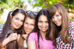 Young and attractive girlfriends have fun in park Stock Photography