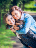 Young and attractive girlfriends have fun Royalty Free Stock Image
