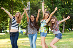 Young and attractive girlfriends in park Royalty Free Stock Images