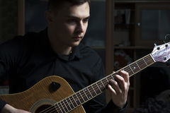 Young attractive guitarist playing Royalty Free Stock Photo