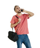 Young attractive guy chatting on his mobile phone Stock Image