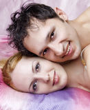 Young attractive happy amorous couple at bed Stock Images