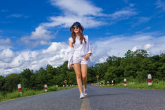 Young attractive happy asian teenager woman, in white shirt, sho Royalty Free Stock Photo