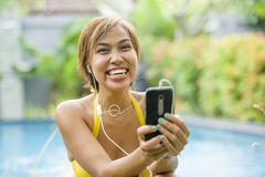 Young attractive and happy Asian woman using social media intern Stock Photo