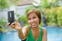 Happy Asian woman taking selfie picture for social media interne Stock Images