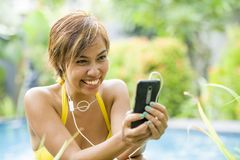 Young attractive and happy Asian woman using social media intern Royalty Free Stock Photos