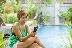 Young attractive and happy Asian woman using social media intern Royalty Free Stock Photography