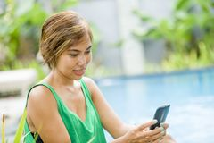 Young attractive and happy Asian woman using social media intern Royalty Free Stock Photo