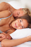 Young attractive happy couple in the bedroom Stock Images