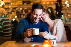 Young attractive couple on date in bar. Young attractive and happy couple on date in bar Royalty Free Stock Photos