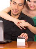 Young attractive happy couple in front of computer Royalty Free Stock Image