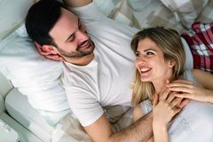 Young attractive couple having romantic time in bed Royalty Free Stock Photo