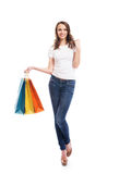 A young, attractive and happy girl with shopping bags Stock Images