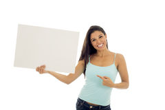 Young attractive and happy hispanic woman holding blank billboard with copy space. Isolated on white background in advertising concept Stock Image