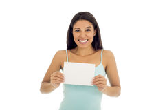 Young attractive and happy hispanic woman holding blank card with copy space Royalty Free Stock Photo