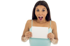 Young attractive and happy hispanic woman holding blank card with copy space Stock Photo