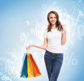 Young, attractive and happy shopping girl with bags Stock Photos