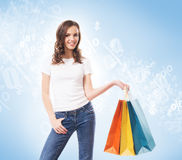 Young, attractive and happy shopping girl with bags Royalty Free Stock Images