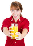 Young attractive happy woman with glass of orange juice Stock Photos
