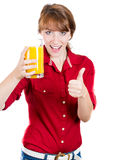 Young attractive happy woman with glass of orange juice Royalty Free Stock Photo