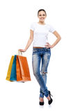 Young, attractive and happy woman with shopping bags Stock Images