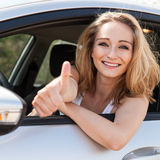 Young attractive happy woman sitting in car Stock Images