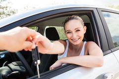 Young attractive happy woman sitting in car Stock Photo