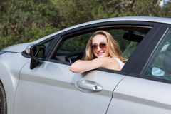Young attractive happy woman sitting in car Royalty Free Stock Photo