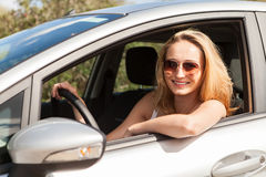 Young attractive happy woman sitting in car Stock Image