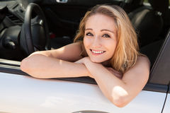 Young attractive happy woman sitting in car Royalty Free Stock Images
