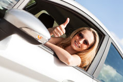 Young attractive happy woman sitting in car summertime Stock Images