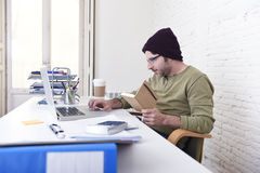Young attractive hipster businessman working from his home office as freelancer self employed business model Stock Photos