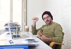 Young attractive hipster businessman working from his home office as freelancer self employed business model Stock Photo