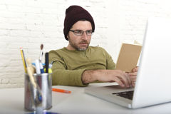 Young attractive hipster businessman working from his home office as freelancer self employed business model Royalty Free Stock Photos