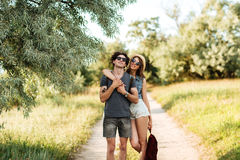 Young attractive hipster couple hugging at the forest Royalty Free Stock Photo