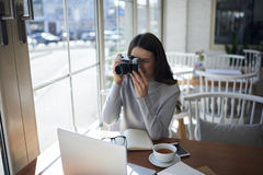 Young attractive hipster girl spending free time on hobby taking picture Stock Photo
