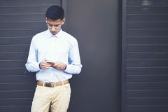 Young attractive hipster guy student in casual wear searching information Stock Photo
