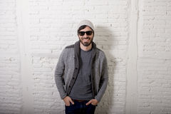 Young attractive hipster and trendy style looking man posing cool with attitude dressing informal Stock Images
