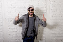Young attractive hipster and trendy style looking man posing cool with attitude dressing informal Stock Photography