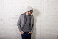 Young attractive hipster and trendy style looking man posing cool with attitude dressing informal Stock Photo