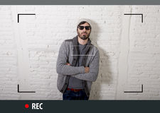 Young attractive hipster and trendy style man in selfie and internet video blogger recording Royalty Free Stock Images