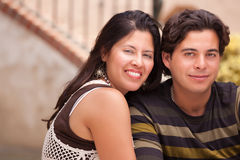 Young Attractive Hispanic Couple At The Park. Happy Attractive Hispanic Couple Enjoying Themselves At The Park Royalty Free Stock Photography