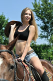 Young attractive  horseback riding Royalty Free Stock Photos